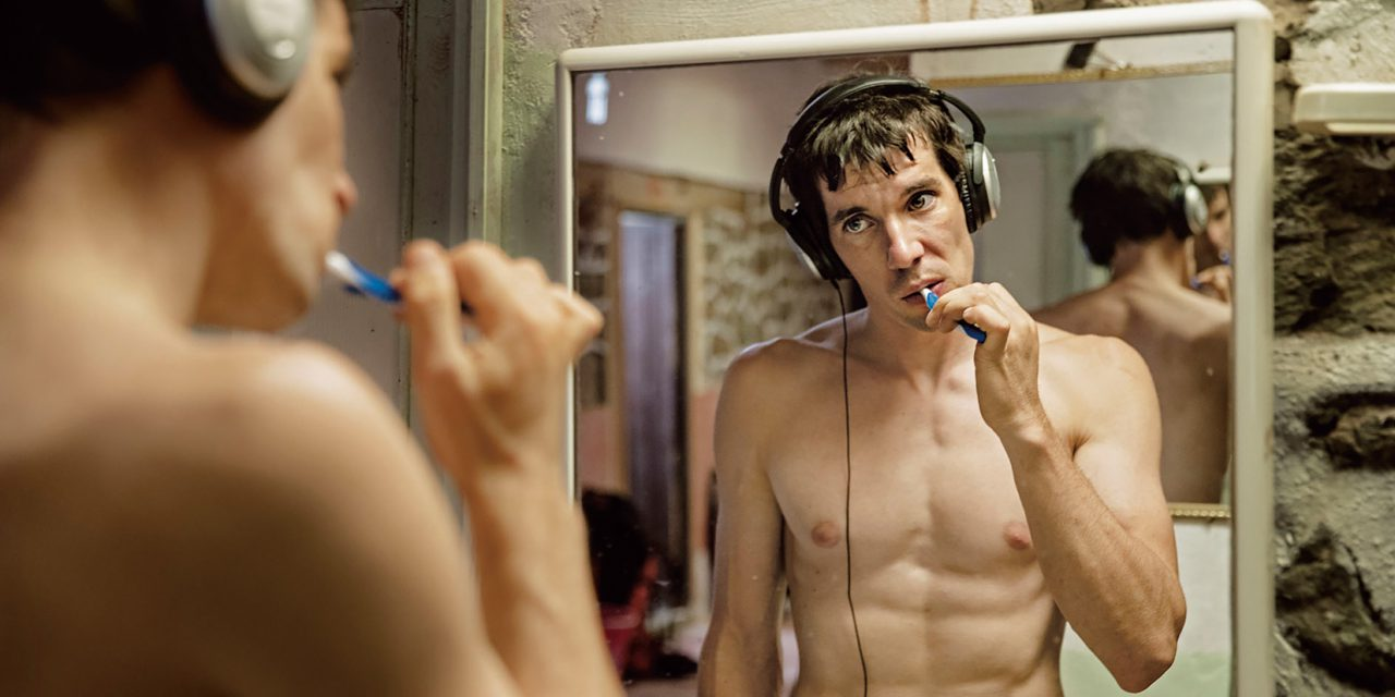 Honnold, 33, listens to music while brushing his teeth as he prepares for a day of climbing in Morocco's High Atlas Mountains, one of several foreign locations where he trained for his attempt on El Capitan. (Jimmy Chin)